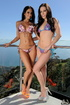 Pussy hungry brunettes in colorful bikinis in stunning photos lick cunt