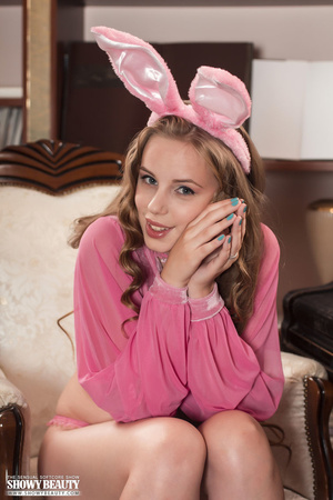 Gorgeous young chick displays her alluring boobs and body wearing her pink bunny ears and blouse before she removes her panty and shows her lusty pussy on a white and brown couch. - XXXonXXX - Pic 20