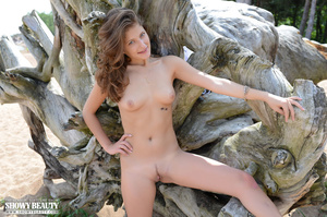 Smoking hot babe peels off her blue dress then displays her banging body in white underwear and high heels then she gets naked and displays her alluring tits and sweet crack by a big tree at the beach. - XXXonXXX - Pic 9