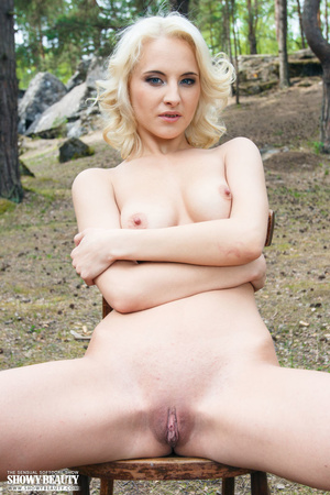 Blonde bombshell sits on a brown wooden chair outdoor then teases with her luscious body as she strips off her blue sweater and reveals her indulging boobs and pussy. - XXXonXXX - Pic 10