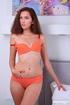 Smoking hot babe pose her banging body in orange…