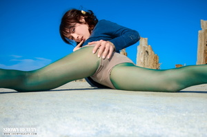 Pretty brunette wearing multi-colored bonnet planking by the beach in her blue shirt and green stockings before she gets naked and bares her stunning body with luscuous pussy in different poses wearing her black and white striped socks and orange slippers. - XXXonXXX - Pic 2