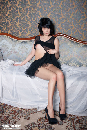 Cute babe peels off her black nighty and shows her sweet boobs before she spreads her legs wide on a blue couch and reveals her indulging pussy under her black skirt wearing her black high heels. - XXXonXXX - Pic 10