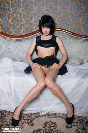 Cute babe peels off her black nighty and shows her sweet boobs before she spreads her legs wide on a blue couch and reveals her indulging pussy under her black skirt wearing her black high heels. - XXXonXXX - Pic 12