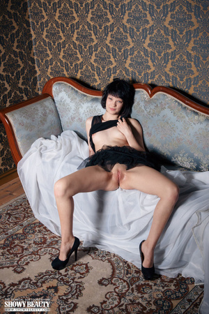 Cute babe peels off her black nighty and shows her sweet boobs before she spreads her legs wide on a blue couch and reveals her indulging pussy under her black skirt wearing her black high heels. - XXXonXXX - Pic 16