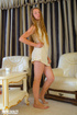 Pretty teen blonde with skinny body slowly peels off her yellow dress