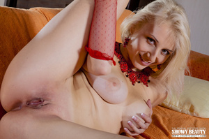 Blonde bombshell seduces with her alluring body in red lingerie before she slowly gets naked and reveals her soft tits and indulging pussy as she spreads her legs wide in different poses on an orange couch. - XXXonXXX - Pic 11