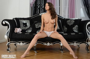 Hot brunette with banging body in pearl white underwear takes off her bra and teases with her alluring tits before she strips down her panty and shows her indulging pussy while she displays her sexy curves on a black and silver couch. - XXXonXXX - Pic 3