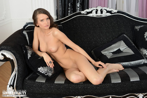 Hot brunette with banging body in pearl white underwear takes off her bra and teases with her alluring tits before she strips down her panty and shows her indulging pussy while she displays her sexy curves on a black and silver couch. - XXXonXXX - Pic 18