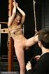 Nasty mistress fucks her pretty slave with a big dildo