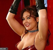 Hot bitch in a red corset gets spanked so well