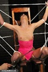 Tied up MILF lady enjoys a dildo up her cunt