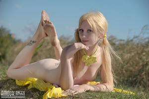 Blonde model with a hat posing in the field - XXXonXXX - Pic 15