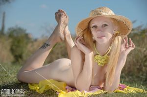 Blonde model with a hat posing in the field - XXXonXXX - Pic 16