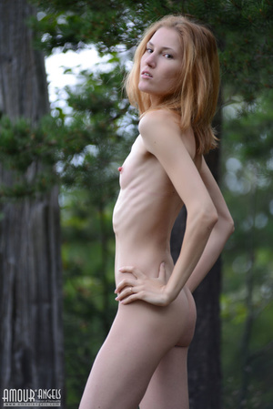 Beautiful redhead lady takes off her clothes outdoors - XXXonXXX - Pic 17