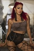 Slutty, slender ebony with fiery red hair is fisted and double penetrated