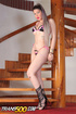 Scrumptious tranny in a black bikini presents her parts at the stairs.