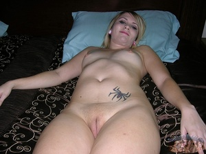 Stunning blonde hottie displays her stunning body on a gray couch then takes off her pink and white striped tube shirt and jeans shorts and teases with her lusty tits as she pose topless then strips down her black panty and bares her indulging pussy on a black bed before she gets on her knees and sucks her boyfriend's cock til it blows on her face. - XXXonXXX - Pic 7