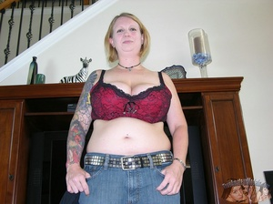 Chubby babe strips off her black shirt and black and maroon bra then releases her monster juggs before she peels down her jeans and black and maroon panty and expose her indulging pussy in different poses on a gray couch and brown bed. - XXXonXXX - Pic 3