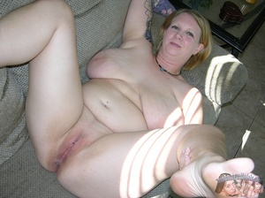 Chubby babe strips off her black shirt and black and maroon bra then releases her monster juggs before she peels down her jeans and black and maroon panty and expose her indulging pussy in different poses on a gray couch and brown bed. - XXXonXXX - Pic 9