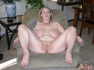 Chubby babe strips off her black shirt and black and maroon bra then releases her monster juggs before she peels down her jeans and black and maroon panty and expose her indulging pussy in different poses on a gray couch and brown bed. - XXXonXXX - Pic 10