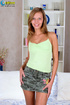 Captivating woman in a green shirt and camo skirt…