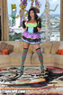 Loose tart-with-a-cock in a colorful dress and striped stockings takes