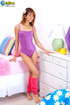 Captivating dame in a purple leotard shows off her naked figure in the