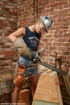 Powered dildo makes happy babe at a construction site