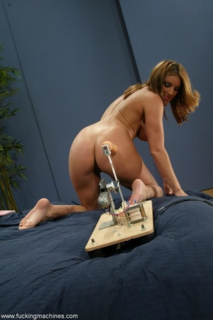 Woman has a mechanized dildo to feed sex hunger in the bed - XXXonXXX - Pic 1