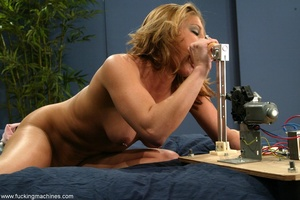 Woman has a mechanized dildo to feed sex hunger in the bed - XXXonXXX - Pic 2