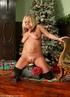 Santa makes miracles for a good girl by the Christmas tree