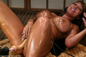 Oiled MILF with huge shapes gets drilled by machine - XXXonXXX - Pic 13