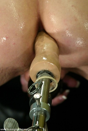 Lady puts condom on dildo machine before a brutal anal sex - XXXonXXX - Pic 11
