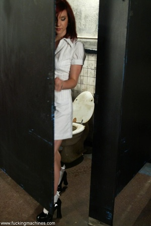 Redhead has some fun with fucking machines in the toilet - XXXonXXX - Pic 1