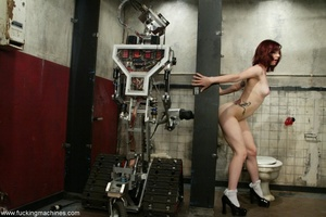 Redhead has some fun with fucking machines in the toilet - XXXonXXX - Pic 5