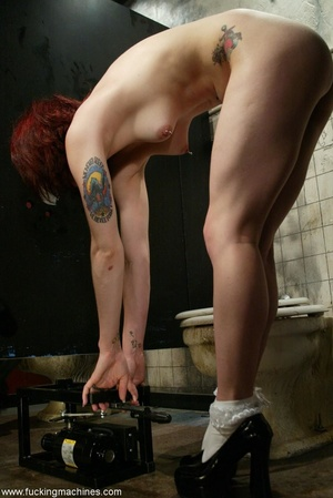 Redhead has some fun with fucking machines in the toilet - XXXonXXX - Pic 10