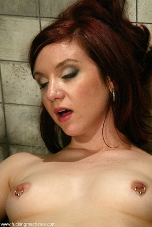 Redhead has some fun with fucking machines in the toilet - XXXonXXX - Pic 12