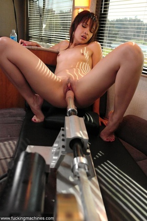 Cute doll enjoys getting fucked by a huge sex machine - XXXonXXX - Pic 15