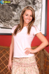 Loose belle in a pink top, floral skirt and pink undies displays her naked