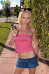 Captivating dame in a pink crop top and denim…
