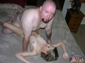 Teen blonde expose her skinny body with tiny tits and stimulating pussy as she pose naked before she gets on her knees and sucks a fat dude's cock then lets him eat her pussy before he fucks her in different positions on a gray bed. - XXXonXXX - Pic 7