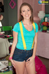 Juicy beav in a green shirt, denim shorts and yellow suspenders cowgirls