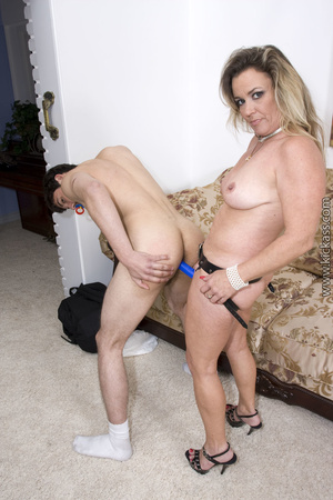 Bonde cougar pulls down her black thong and expose her indulging crack before she drill a hot guy with strap on. - XXXonXXX - Pic 12