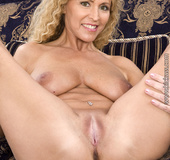 Blonde MILF releases her large juicy breasts and makes a dude in diapers