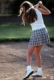 teenage chick playing golf