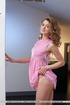 Gorgeous hottie displays her hot body in pretty pink dress before she
