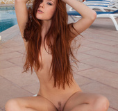 Sizzling hot redhead seduces with her stimulating body outdoor wearing