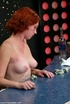 Modest ginger rides a dildo sitting on the bar counter