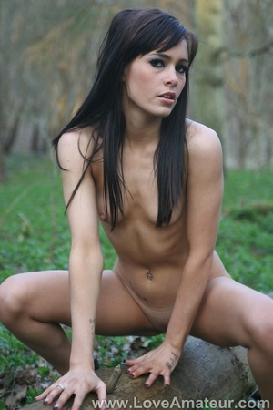 Bony a-cup brunette spreads wide showing her shaved pussy in the woods - XXXonXXX - Pic 3